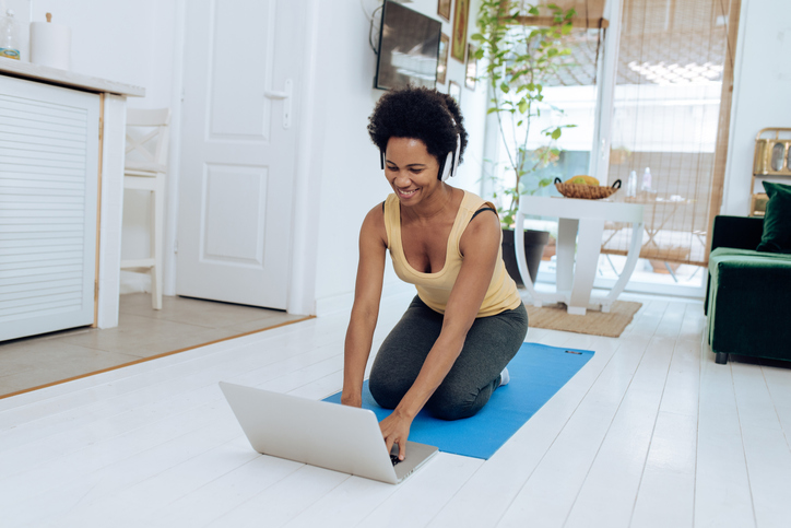 African-American yoga instructor preparing for her online class