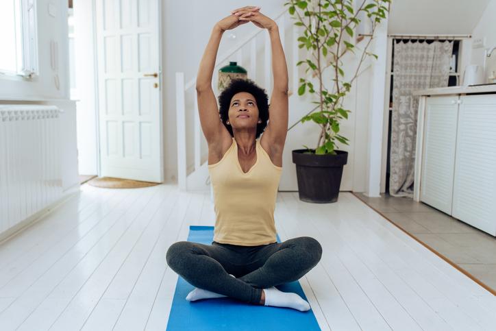 African-American woman practicing yoga at home