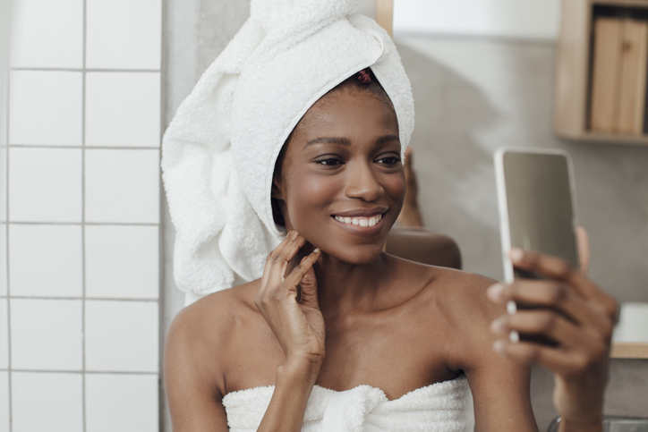 Smiling Woman Taking Selfie After Bath