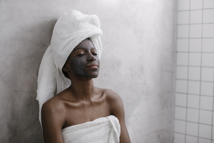Portrait of a Woman with Charcoal Face Mask