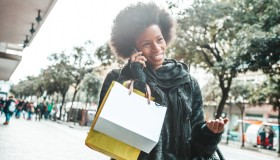 Woman goes to shopping and talking on mobile phone