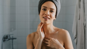 Beautiful African American Woman Wrapped in a Towel after Having a Shower