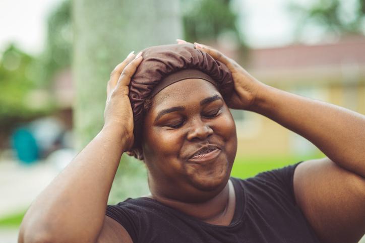 African American woman in a hair cap