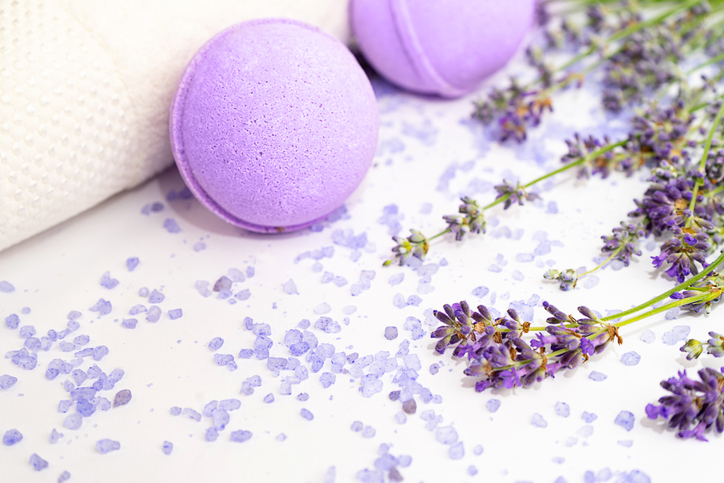 Lavender flowers and beauty products isolated on white background.