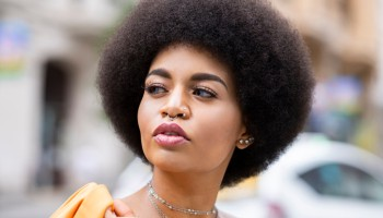 Afro woman contemplating outdoors