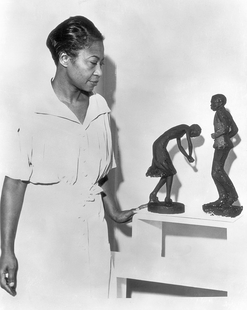 Augusta Savage Viewing Two of Her Sculptures