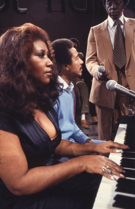 """Aretha Franklin and Smokey Robinson are seated at the piano and being interviewed by Don Cornelius after performing a live version of """"""""Ooo Baby Baby"""""""" together on Soul Train."""
