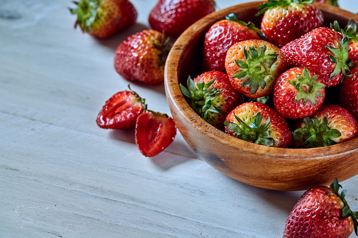 Fresh strawberries on a wooden table