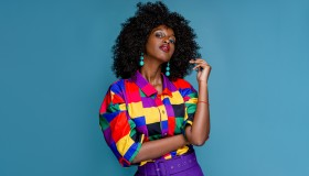Fashionable woman in colorful shirt