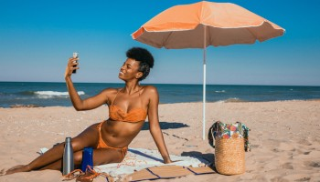 Woman enjoying summertime at the beach
