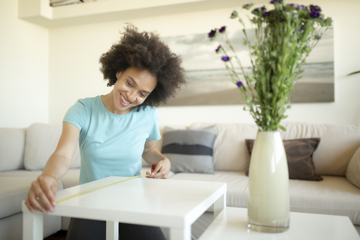 Cheerful African American woman DIY at home