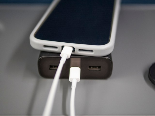 Use a power bank to charge your phone